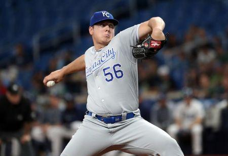 FILE PHOTO: Apr 22, 2019; St. Petersburg, FL, USA;Kansas City Royals starting pitcher Brad Keller (56) throws a pitch during the first inning against the Tampa Bay Rays at Tropicana Field. Mandatory Credit: Kim Klement-USA TODAY Sports/File Photo