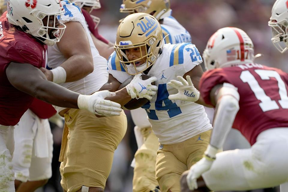 UCLA running back Zach Charbonnet scores a first-half touchdown against Stanford on Sept. 25, 2021.