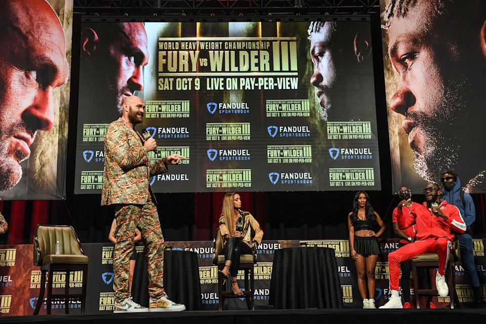 British boxer Tyson Fury (L) and challenger US boxer Deontay Wilder attend a press conference for their WBC heavyweight championship fight, October 6, 2021 at the MGM Grand Garden Arena in Las Vegas, Nevada ahead of their October 9, 2021 fight. (Photo by Robyn Beck / AFP) (Photo by ROBYN BECK/AFP via Getty Images)