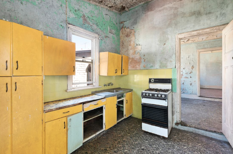 Pictured is the kitchen with yellow cabinets.