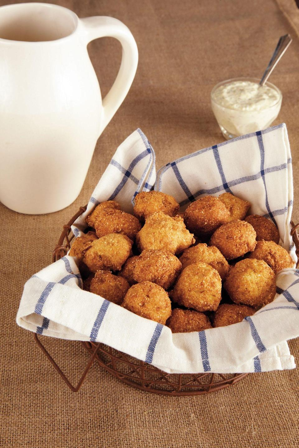 """<p><strong>Recipe:</strong> <a href=""""https://www.southernliving.com/recipes/hush-puppies"""" rel=""""nofollow noopener"""" target=""""_blank"""" data-ylk=""""slk:Hush Puppies"""" class=""""link rapid-noclick-resp"""">Hush Puppies</a></p> <p>Nothing beats a classic hush puppy recipe. Pop a basket of these puppies on the table, and we promise they'll be gone in no time.</p>"""