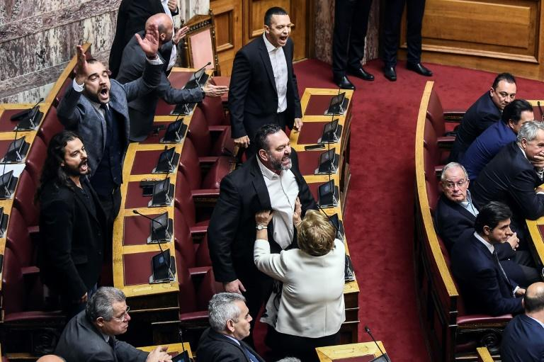 Lawmakers of far-right Golden Dawn party Ioannis Lagos (C), Costas Barbarousis (L) and Panayiotis Iliopoulos yell during a parliament session. The neo-Nazi party is the fourth largest in the Greek parliament