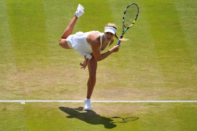 Canada's Eugenie Bouchard returns to Germany's Angelique Kerber during their quarter-final match at Wimbledon on July 2, 2014 (AFP Photo/Glyn Kirk)