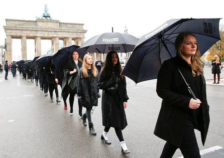 FILE PHOTO: Activists take part in 'Walk for Freedom' to protest against human trafficking in front of Brandenburg Gate in Berlin