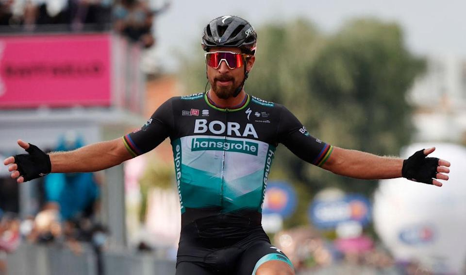 Team Bora rider Slovakias Peter Sagan celebrates as he crosses the finish line in the 10th stage of the Giro dItalia 2020 cycling race a 177kilometer route between Lanciano and Tortoreto on October 13 2020 Photo by Luca Bettini  AFP Photo by LUCA BETTINIAFP via Getty Images