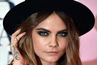 """<p>Delevingne has her initials, """"CJD,"""" tattooed on the side of her right hand. (Her full name is Cara Jocelyn Delevingne.)</p>"""