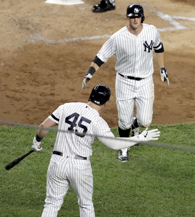 New York Yankees' DJ LeMahieu, right, is greeted near home plate by Luke Voit (45) after hitting a solo home run off Boston Red Sox starting pitcher Chris Sale during the fifth inning of a baseball game Friday, May 31, 2019, in New York. (AP Photo/Julio Cortez)