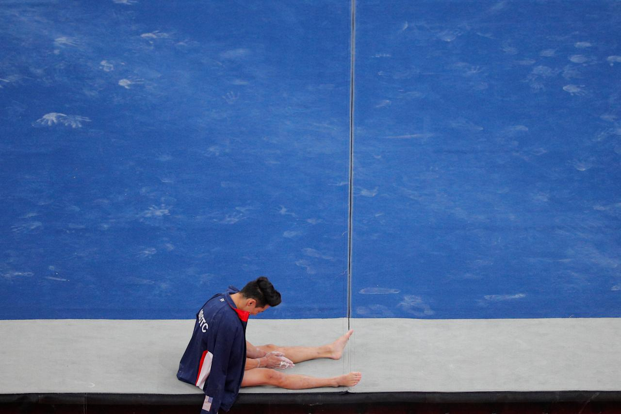 Kanji Oyama waits to compete on the floor exercise at the U.S. Gymnastics Championships in Boston, Massachusetts, U.S., August 16, 2018.     REUTERS/Brian Snyder