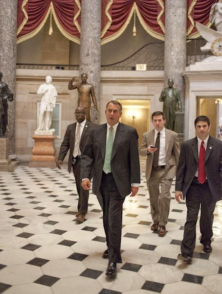 House Speaker John Boehner of Ohio walks to the House floor on Capitol Hill in Washington, Tuesday, Nov. 13, 2012, as the lame duck 112th Congress began. (AP Photo/Harry Hamburg)