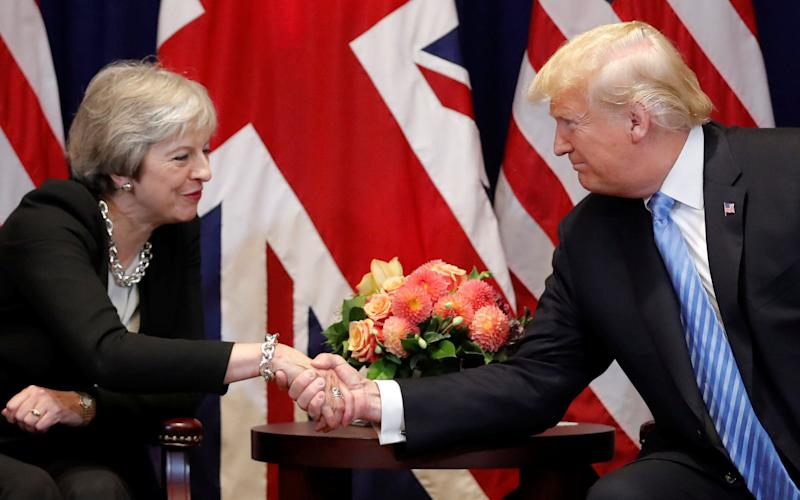 Donald Trump and Theresa May in a meeting in September - REUTERS