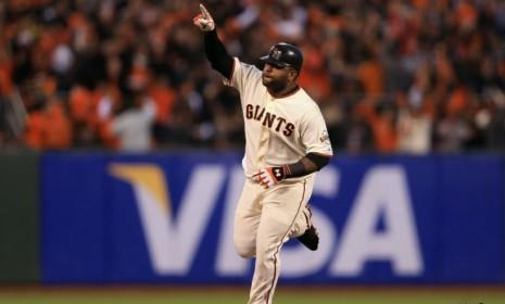 Pablo Sandoval rounds the bases after hitting a solo home run during Game 1 of the World Series against the Detroit Tigers.