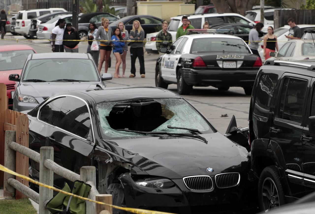 The vehicle of the alleged shooter is pictured at one of the crime scenes after a series of drive-by shootings in the Isla Vista section of Santa Barbara May 24, 2014. A lone gunman sprayed bullets from a car in a drive-by shooting in a southern California college town, killing at least six people before his car crashed and he was found dead inside, authorities said on Saturday. REUTERS/Jonathan Alcorn (UNITED STATES - Tags: CRIME LAW)