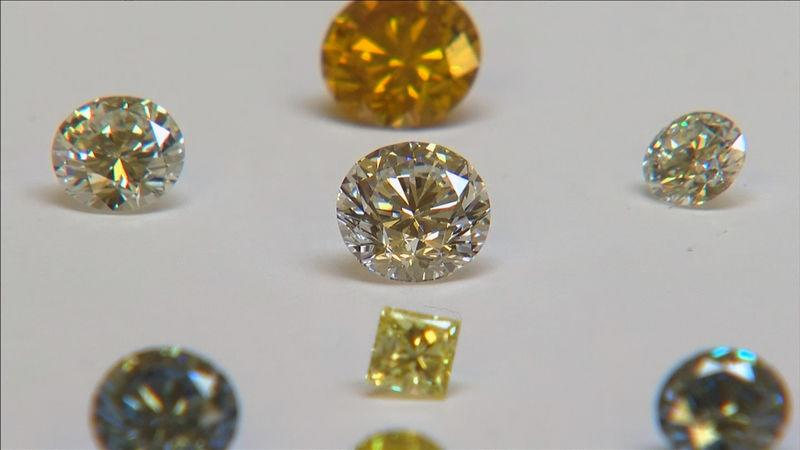 FILE PHOTO: A still image from video shows coloured synthetic diamonds on display at De Beers' International Institute of Diamond Grading and Research in Maidenhead