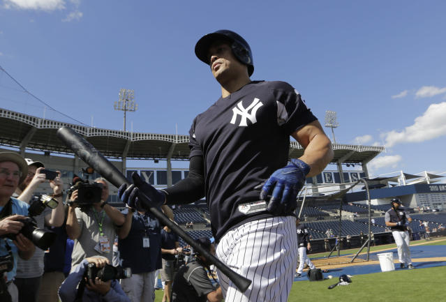 New York Yankees' Giancarlo Stanton walks off the field after batting practice at baseball spring training camp, Monday, Feb. 19, 2018, in Tampa, Fla. (AP Photo/Lynne Sladky)