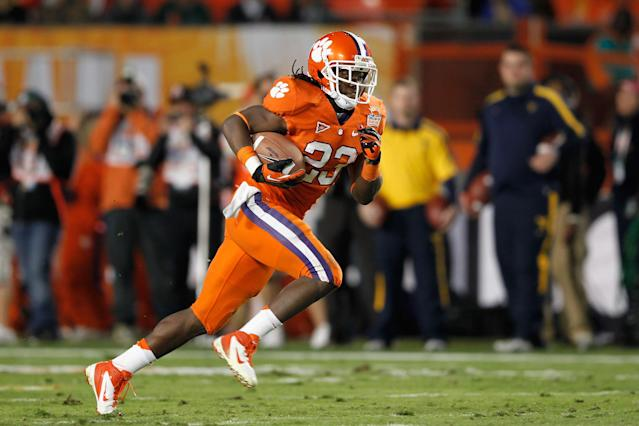 MIAMI GARDENS, FL - JANUARY 04: Andre Ellington #23 of the Clemson Tigers runs for a 68-yard rushing touchdown in the first quarter against the West Virginia Mountaineers during the Discover Orange Bowl at Sun Life Stadium on January 4, 2012 in Miami Gardens, Florida. (Photo by Streeter Lecka/Getty Images)