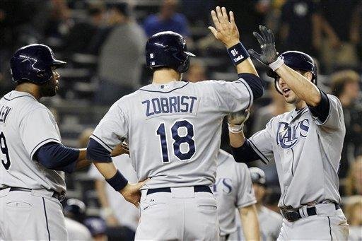 Tampa Bay Rays' Brandon Allen, left, and Ben Zobrist (18) greet Matt Joyce at the plate after Joyce hit a ninth-inning, three-run home run off New York Yankees closer David Robertson to give the Rays a 4-1 victory in their baseball game at Yankee Stadium in New York, Wednesday, May 9, 2012. (AP Photo/Kathy Willens)