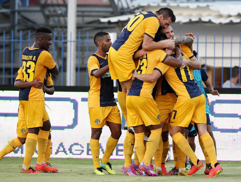 AEL Limassol's players celebrate after scoring a goal against Tottenham Hotspur during their UEFA Europa League playoff match, at the Antonis Papadopoulos stadium in Larnaca, Cyprus, on August 21, 2014 (AFP Photo/Sakis Savvides)