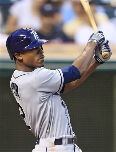 Tampa Bay Rays' B.J. Upton hits an RBI-single off Cleveland Indians' Nick Hagadone in the fifth inning of a baseball game, Friday, July 6, 2012, in Cleveland. Desmond Jennings scored. (AP Photo/Tony Dejak)