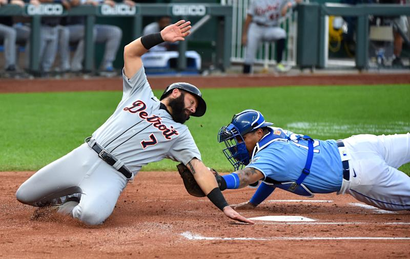 Tigers catcher Austin Romine is tagged out as he tries to score against Royals catcher Salvador Perez in the first inning of the Tigers' 4-3 win in Kansas City, Missouri, on Saturday, Sept. 26, 2020.