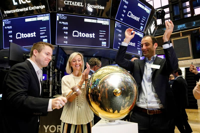 Toast co-Founder Jonathan Grimm, rings a ceremonial bell to celebrate his company's IPO at the NYSE in New York