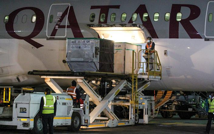 The first arrival of COVID-19 vaccines to Kenya is offloaded from a Qatar Airways flight at Jomo Kenyatta International Airport in Nairobi, Kenya, early Wednesday - STR/AP