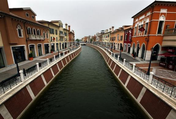 A canal flows through the center of the Florentia Village in the district of Wuqing, located on the outskirts of the city of Tianjin June 13, 2012.