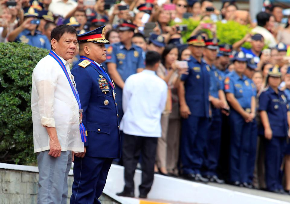 """FILE PHOTO: Philippine President Rodrigo Duterte (L) stands next to former Philippine National Police (PNP) Director General Ronald """"Bato"""" Dela Rosa during the PNP Assumption of Command Ceremony at police headquarters in Quezon City, Metro Manila, Philippines July 1, 2016. REUTERS/Romeo Ranoco"""