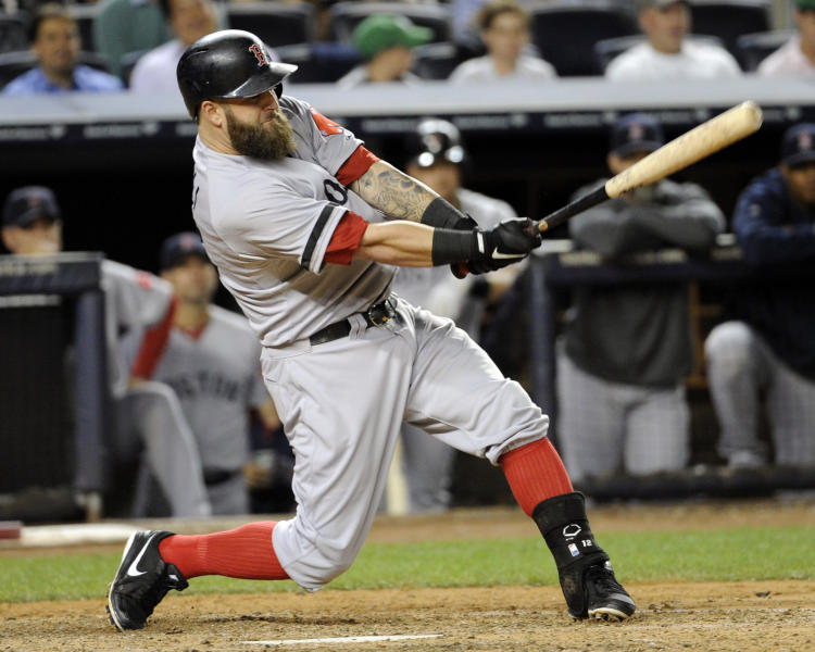 Boston Red Sox's Mike Napoli hits an RBI-single during the fifth inning of a baseball game against the New York Yankees, Thursday, Sept. 5, 2013, at Yankee Stadium in New York. (AP Photo/Bill Kostroun)