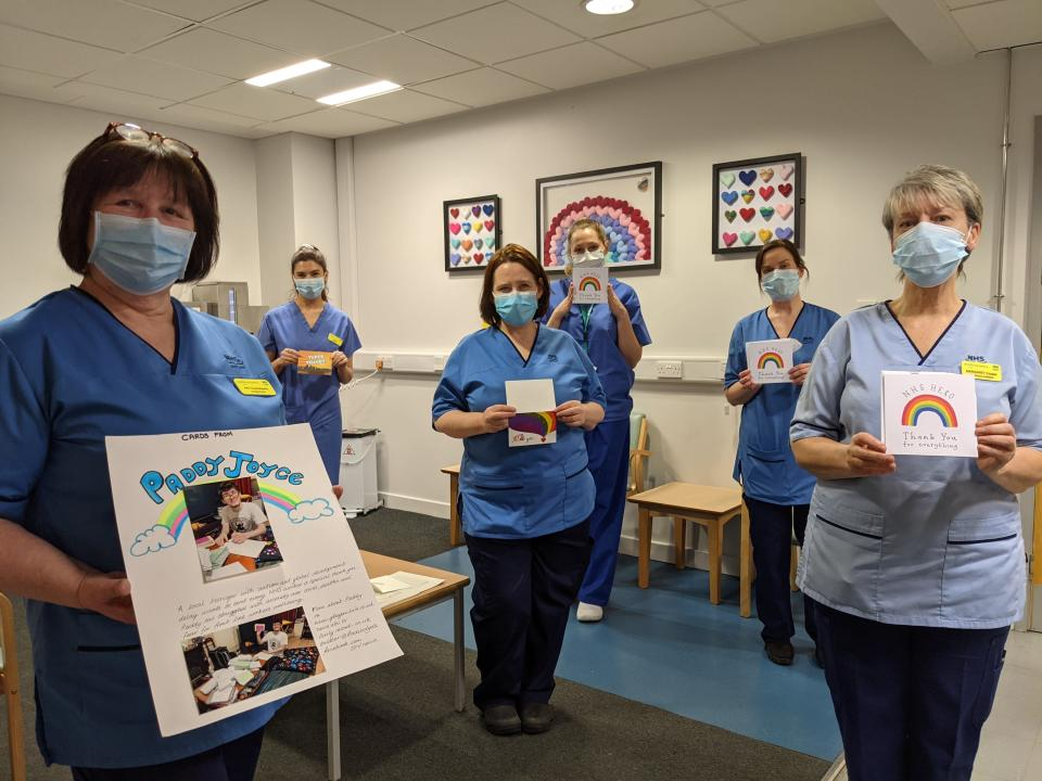 Hospital staff with cards