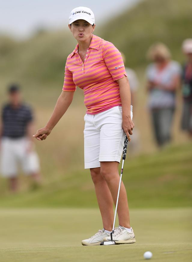 Mo Martin of the US putts on the 11th green during the third day of the Women's British Open golf championship, at the Royal Birkdale Golf Club, in Southport, England, Saturday, July 12, 2014. (AP Photo/Scott Heppell)