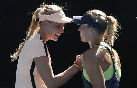 Kerber fights back tears after Sharapova romp