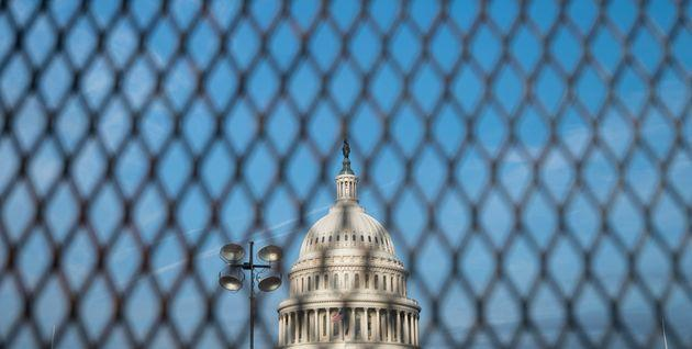 The newly erected temporary security fence on the East Front of the Capitol is among the preparations officials have made ahead of the Sept. 18 rally to hail Capitol protesters. (Photo: Bill Clark via Getty Images)