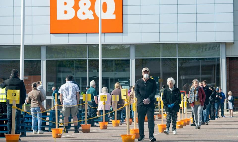 Customers social distancing in the car park of B&Q.