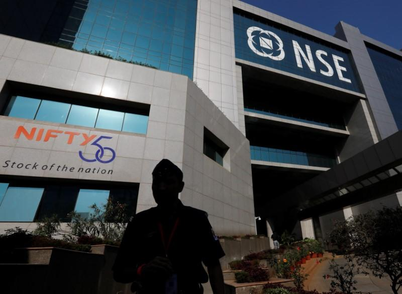 A guard walks past the NSE (National Stock Exchange) building in Mumbai