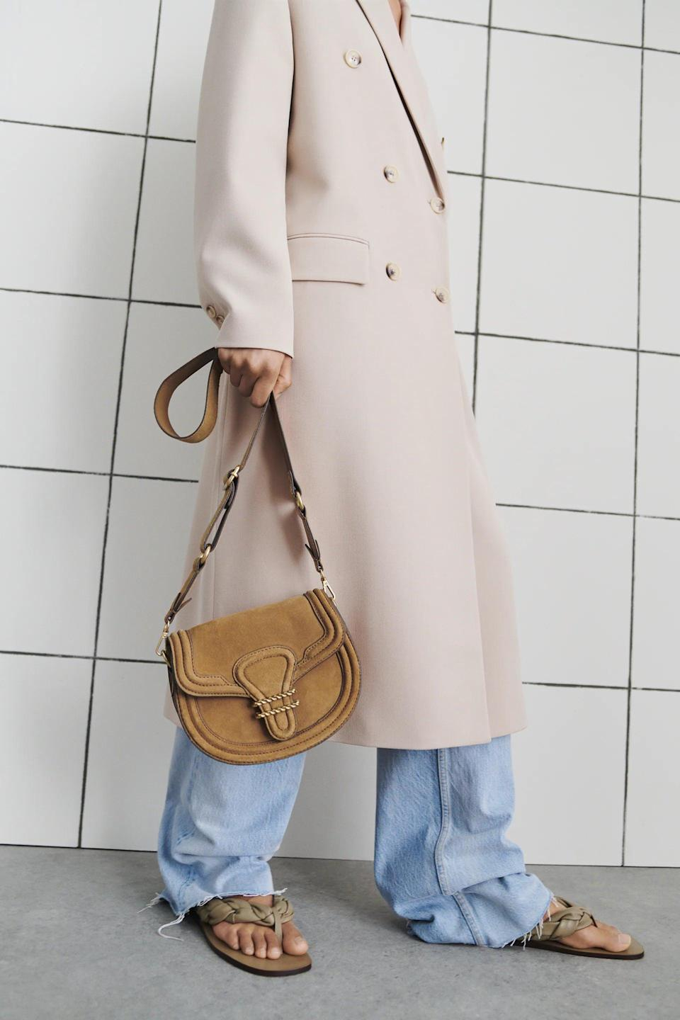 <p>This <span>Zara Oval Split Leather Crossbody Bag</span> ($90) has a 70's vibe that we love. It'll be a staple in your closet for years to come.</p>