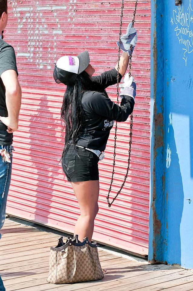 """It was back to work for the """"Jersey Shore"""" crew on Wednesday as they got The Shore Store, their T-shirt shop at the Seaside Heights Boardwalk, up and running. Even Snooki had to do a little manual labor! Fans of the Snookster will be happy to know that she'll be the topic of the next """"E! True Hollywood Story"""" on July 27. """"Our show blew up and I never knew it was gonna happen, cause it coulda' flopped and it coulda' been the most embarrassing thing in the world, you know? And I probably couldn't get a job after that,"""" she said during an interview with the show. Wait a second, Snooki isn't embarrassed yet? Thelonius/<a href=""""http://www.splashnewsonline.com"""" target=""""new"""">Splash News</a> - July 6, 2011"""