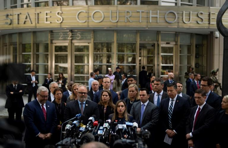 US officials speak outside Brooklyn's federal courthouse after the highly anticipated life sentencing of the drug kingpin
