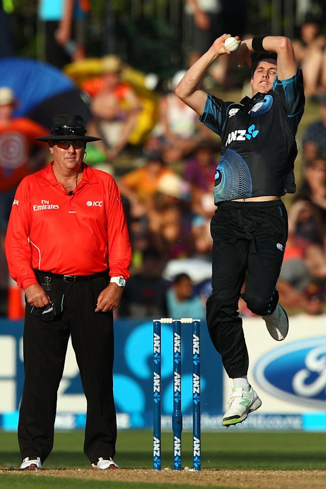 NAPIER, NEW ZEALAND - JANUARY 19:  Adam Milne of New Zealand bowls during the first One Day International match between New Zealand and India at McLean Park on January 19, 2014 in Napier, New Zealand.  (Photo by Hagen Hopkins/Getty Images)