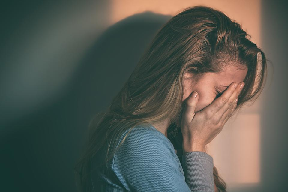 Upset young woman reflect dip and soar in headspace psychosis program access because of coronavirus