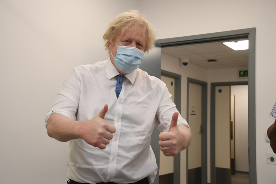 Prime Minister Boris Johnson during a visit to a coronavirus vaccination centre at the Health and Well-being Centre in Orpington, south-east London. Picture date: Monday February 15, 2021.