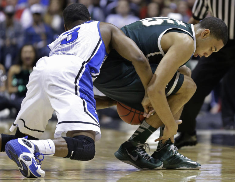 Michigan State guard Denzel Valentine and Duke guard Tyler Thornton (3) scramble for a loose ball during the first half of a regional semifinal in the NCAA college basketball tournament, Friday, March 29, 2013, in Indianapolis. (AP Photo/Michael Conroy)