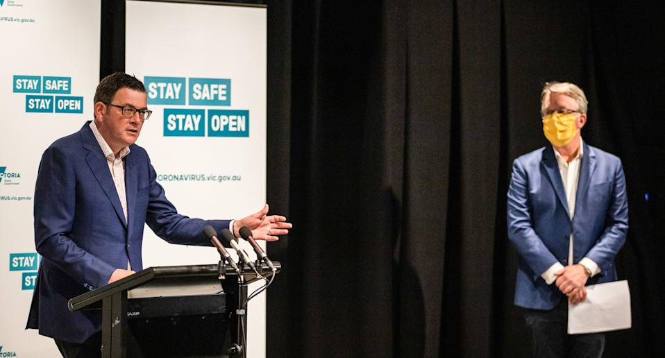 Premier Daniel Andrews (L) speaks during a press conference announcing the further steps to ease the restrictions.
