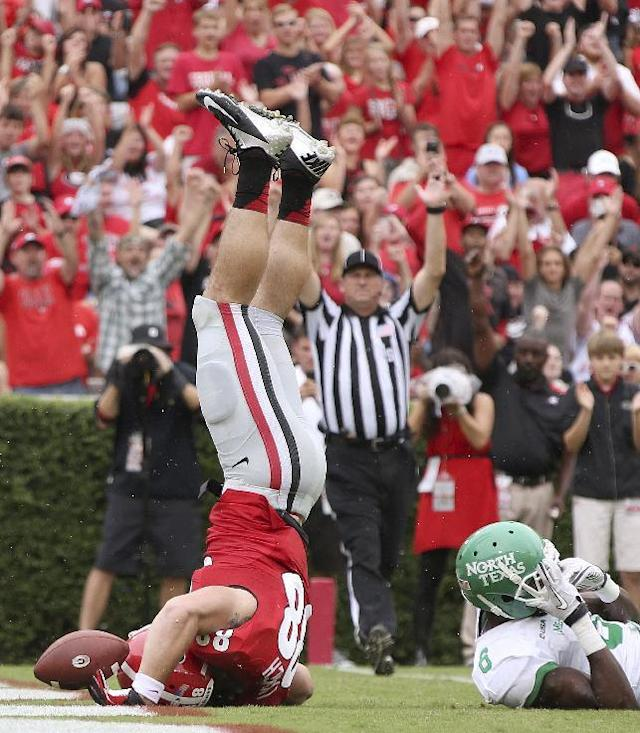 Georgia tight end Arthur Lynch holds onto the ball long enough as he's up ended following his 16-yard touchdown catch from quarterback Aaron Murray in the first half of an NCAA college football game against North Texas at Sanford Stadium Saturday, Sept. 21, 2013, in Athens, Ga. (AP Photo/Atlanta Journal-Constitution, Jason Getz)
