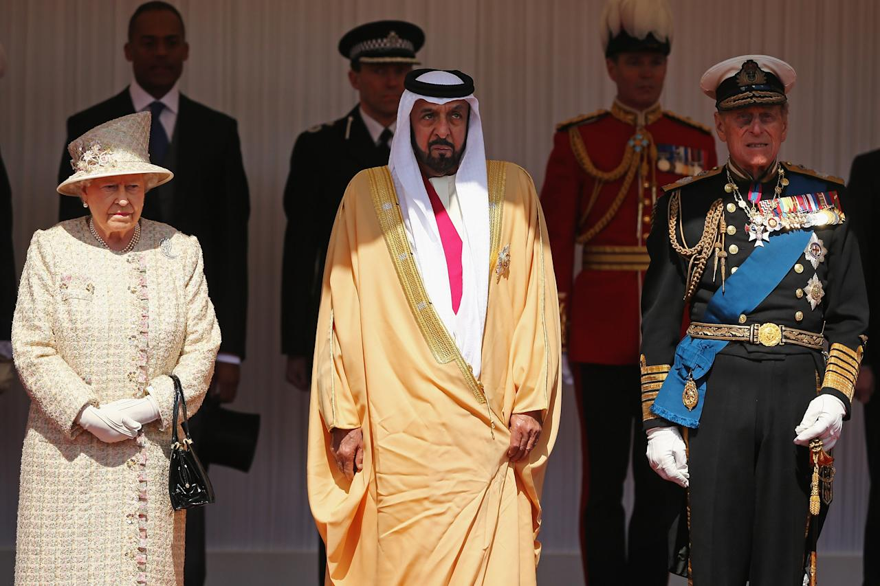 WINDSOR, ENGLAND - APRIL 30:  Queen Elizabeth II and Prince Philip, the Duke of Edinburgh pose with The President of the United Arab Emirates, His Highness Sheikh Khalifa bin Zayed Al Nahyan on the Royal Dais on April 30, 2013 in Windsor, England. President Sheikh Khalifa begins a State visit to the UK today, the first for a UEA President in 24 years. Sheikh Khalifa will meet the British Prime Minister David Cameron tomorrow at his Downing Street residence.  (Photo by Dan Kitwood/Getty Images)