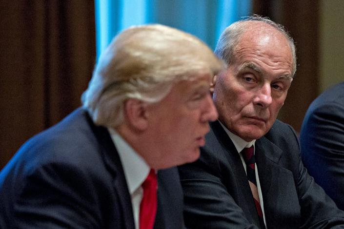 Former White House chief of staff John Kelly listens as ex-US president Donald Trump speaks at a briefing with senior military leaders at the White House 5 October 2017 (Getty Images)