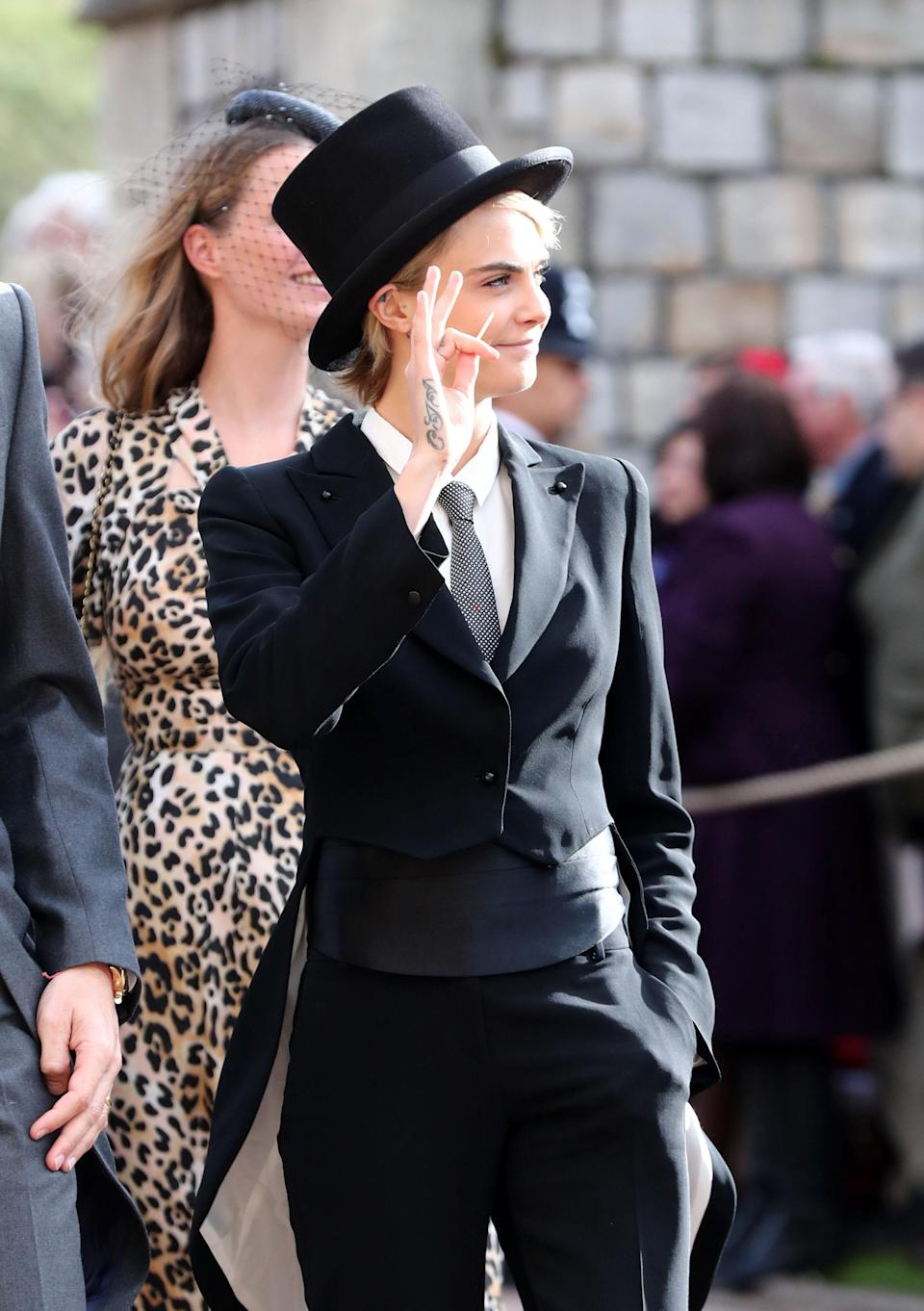 <p>When Cara Delevingne arrived in a top hat and tails putting a twist on the royal dress code. Hey, it's 2018 after all! </p>