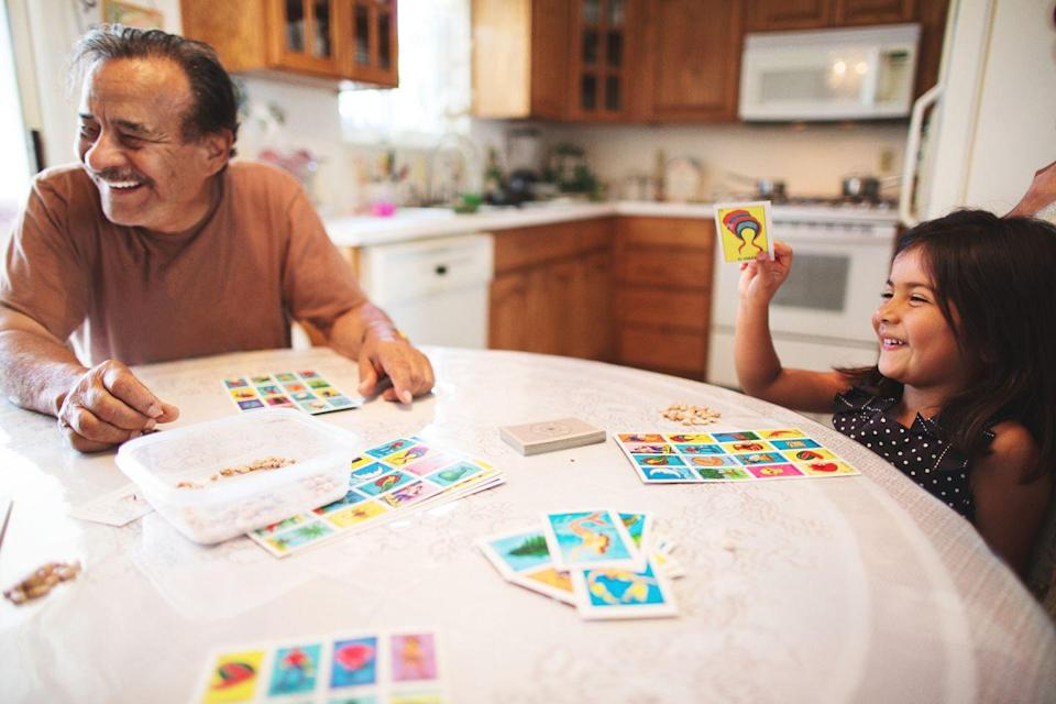 """<p>Everyone loves a game night. Gather around the table for a <a href=""""https://www.amazon.com/Millennial-Loteria-Mike-Alfaro/dp/1944515801"""" rel=""""nofollow noopener"""" target=""""_blank"""" data-ylk=""""slk:round of lotería"""" class=""""link rapid-noclick-resp"""">round of lotería</a>, a Mexican bingo game known for its <a href=""""https://www.amazon.com/Don-Clemente-Autentica-Colorful-Educational/dp/B005268AAO/"""" rel=""""nofollow noopener"""" target=""""_blank"""" data-ylk=""""slk:colorful cards"""" class=""""link rapid-noclick-resp"""">colorful cards</a>, which has long held a <a href=""""https://www.oprahdaily.com/entertainment/a32141190/loteria-cards-meaning/"""" rel=""""nofollow noopener"""" target=""""_blank"""" data-ylk=""""slk:powerful nostalgic meaning"""" class=""""link rapid-noclick-resp"""">powerful nostalgic meaning</a> within Latinx and Hispanic communities. Dominoes are another popular pastime for many of <a href=""""https://caribbeantrading.com/dominoes-rules-in-puerto-rico/"""" rel=""""nofollow noopener"""" target=""""_blank"""" data-ylk=""""slk:Puerto Rican"""" class=""""link rapid-noclick-resp"""">Puerto Rican</a>, <a href=""""https://www.dominorules.com/cuban-dominoes"""" rel=""""nofollow noopener"""" target=""""_blank"""" data-ylk=""""slk:Cuban"""" class=""""link rapid-noclick-resp"""">Cuban</a>, and <a href=""""https://bestofpuntacana.com/blog/bop-goes-local/national-sport-punta-cana-dominoes/"""" rel=""""nofollow noopener"""" target=""""_blank"""" data-ylk=""""slk:Dominican heritage"""" class=""""link rapid-noclick-resp"""">Dominican heritage</a> in particular. </p><p><strong><a href=""""https://www.amazon.com/Millennial-Loteria-Mike-Alfaro/dp/1944515801/?tag=syn-yahoo-20&ascsubtag=%5Bartid%7C10072.g.36651645%5Bsrc%7Cyahoo-us"""" rel=""""nofollow noopener"""" target=""""_blank"""" data-ylk=""""slk:Buy the Millenial Loteria game"""" class=""""link rapid-noclick-resp"""">Buy the <em>Millenial Loteria </em>game</a></strong></p>"""