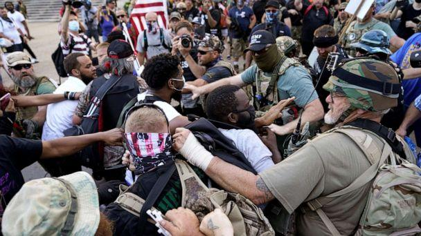 PHOTO: Far-right activists and self-described militia members and Black Lives Matter activists scuffle on the day of the Kentucky Derby horse race in Louisville, Ky., Sept. 5, 2020. (Bryan Woolston/Reuters)