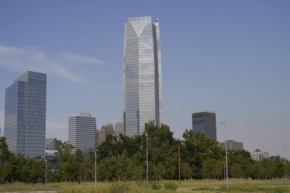 The Devon Energy Tower dwarfs other downtown buildings Monday, Sept. 27, 2021, in Oklahoma City. Oklahoma City-based Devon Energy Corporation has agreed to a $6.15 million settlement agreement with the federal government over allegations it underpaid royalties on federal leases, the U.S. Department of Justice announced Monday. (AP Photo/Sue Ogrocki)