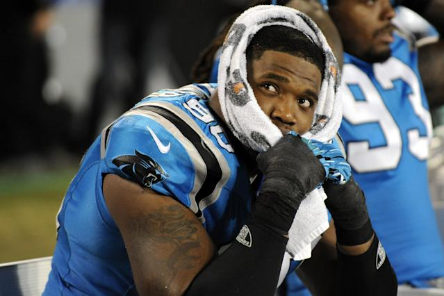 Carolina Panthers defensive end Frank Alexander (90) sits on the bench in the final minutes of the fourth quarter of an NFL football game against the New York Giants in Charlotte, N.C., Thursday, Sept. 20, 2012. The Giants won 36-7. (AP Photo/Mike McCarn)